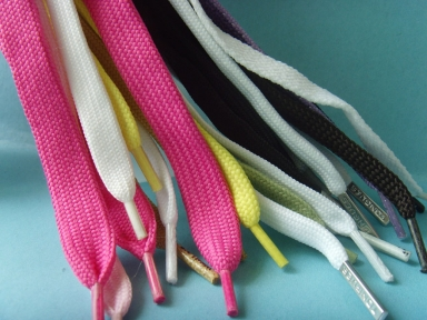 colourful flat tubular shoelace with metal and plastic tips
