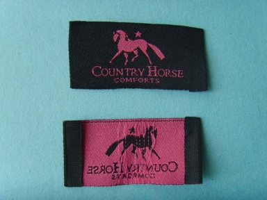 black and pink horse loop fold woven label